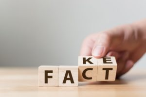 facts versus fakes illustration with wood blocks